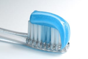 Toothbrush with blue toothpaste on it