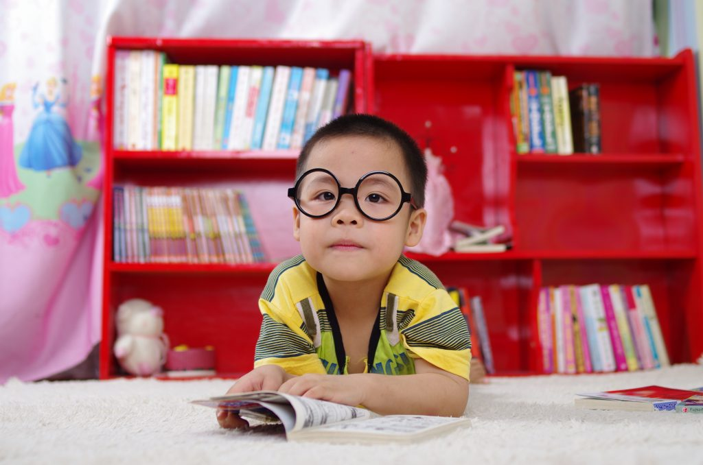 child's eyeglass prescription - child wearing big round glasses